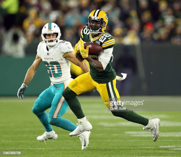 Bashaud Breeland of the Green Bay Packers intercepts a pass intended for Danny Amendola of the Miami Dolphins during the second half of a game at...