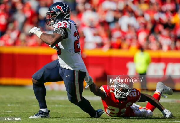 Bashaud Breeland of the Kansas City Chiefs holds on to the jersey of Carlos Hyde of the Houston Texans in the fourth quarter at Arrowhead Stadium on...