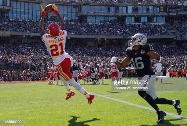 Bashaud Breeland of the Kansas City Chiefs intercepts this pass intended for Tyrell Williams of the Oakland Raiders during the third quarter of an...