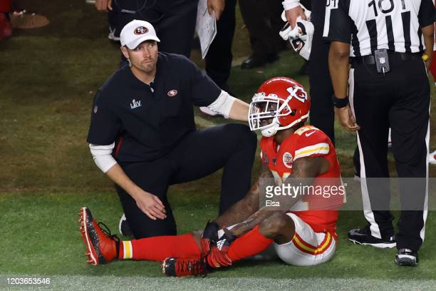 Bashaud Breeland of the Kansas City Chiefs is looked at by a trainer after a injury against the San Francisco 49ers during the third quarter in Super...
