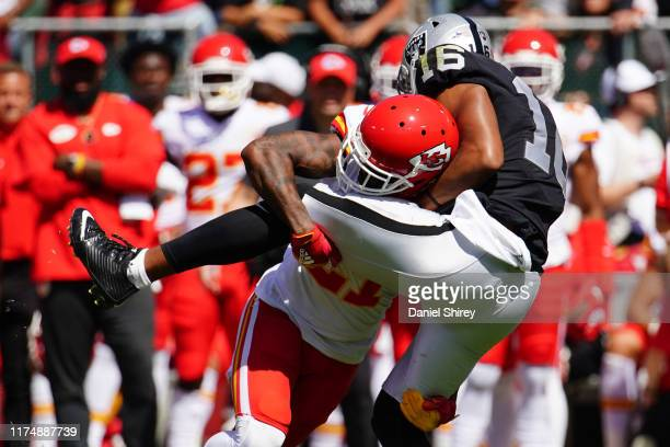 Bashaud Breeland of the Kansas City Chiefs tackles Tyrell Williams of the Oakland Raiders during the first quarter at RingCentral Coliseum on...