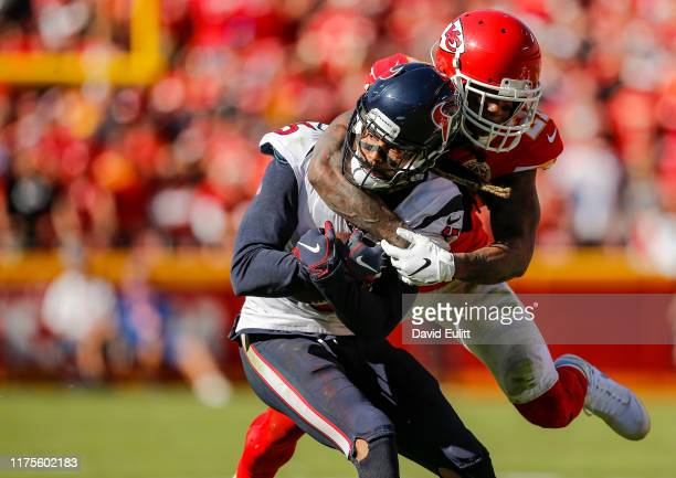 Bashaud Breeland of the Kansas City Chiefs tackles Will Fuller of the Houston Texans in the fourth quarter at Arrowhead Stadium on October 13 2019 in...