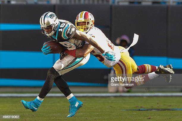 Bashaud Breeland of the Washington Redskins dives to tackle Ted Ginn of the Carolina Panthers during their game at Bank of America Stadium on...