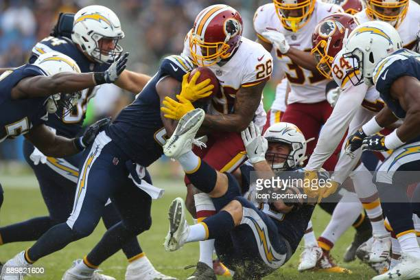 Bashaud Breeland of the Washington Redskins gets tackled by Los Angeles Chargers during a NFL game between the Washington Redskins and the Los...