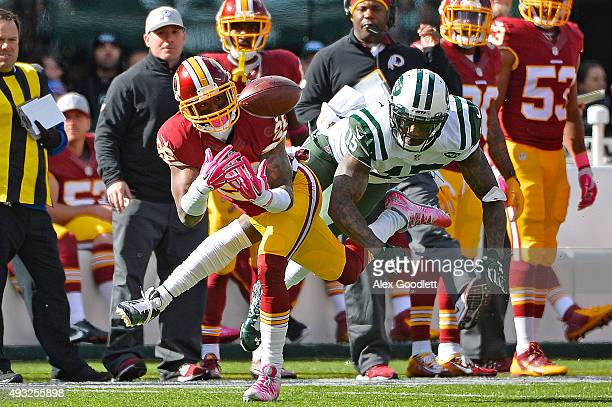 Bashaud Breeland of the Washington Redskins intercepts a pass intended for Brandon Marshall of the New York Jets during the second quarter at MetLife...