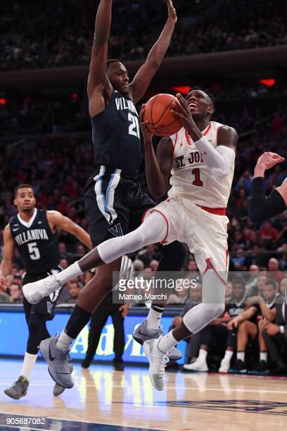Bashir Ahmed of the St John's Red Storm shoots the ball against Dhamir CosbyRoundtree of the Villanova Wildcats during an NCAA men's basketball game...