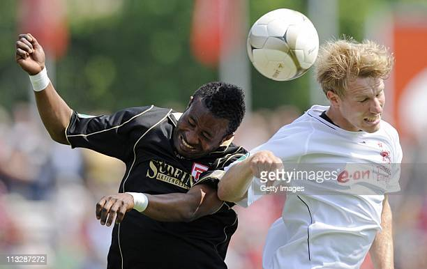 Bashiru Gambo of Regensburg and Jens Moeckel of Erfurt head for the ball during the Third League match between Rot-Weiss Erfurt and Jahn Regensburg...