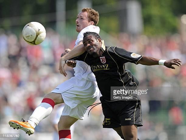 Bashiru Gambo of Regensburg and Nils Pfingsten Reddig of Erfurt battle for the ball during the Third League match between Rot-Weiss Erfurt and Jahn...