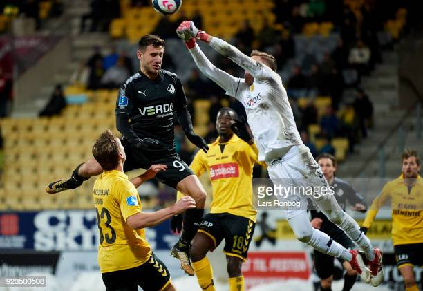 Bashkim Kadrii of Randers FC and Goalkeeper Jesse Joronen of AC Horsens compete for the ball during the Danish Alka Superliga match between AC...
