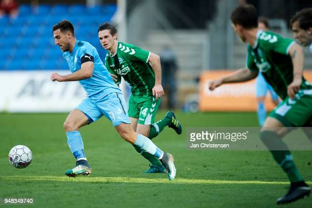 Bashkim Kadrii of Randers FC and Jens Jakob Thomasen of OB Odense compete for the ball during the Danish Alka Superliga match between Randers FC and...
