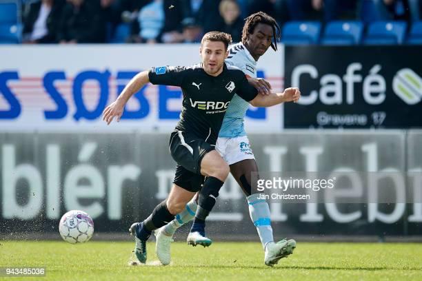 Bashkim Kadrii of Randers FC and Jeppe Simonsen of SonderjyskE compete for the ball during the Danish Alka Superliga match between SonderjyskE and...