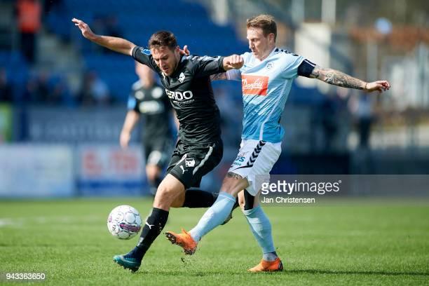 Bashkim Kadrii of Randers FC and Marc Pedersen of SonderjyskE compete for the ball during the Danish Alka Superliga match between SonderjyskE and...