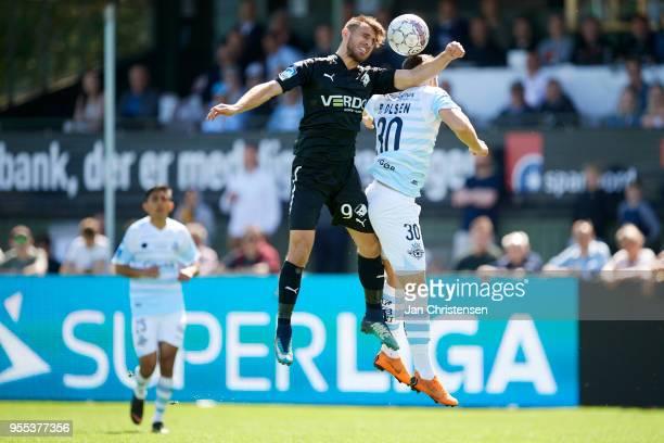 Bashkim Kadrii of Randers FC and Patrick Olsen of FC Helsingor heading the ball during the Danish Alka Superliga match between FC Helsingor and...