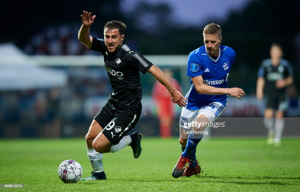 Bashkim Kadrii of Randers FC and Thomas Sorensen of Lyngby BK compete for the ball during the Danish Alka Superliga match between Lyngby BK and Randers FC at Lyngby Stadion on May 17, 2018 in Lyngby, Denmark.