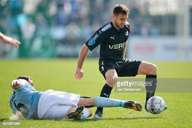 Bashkim Kadrii of Randers FC compete for the ball during the Danish Alka Superliga match between SonderjyskE and Randers FC at Sydbank Park on April...