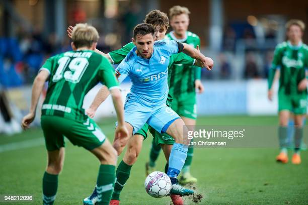 Bashkim Kadrii of Randers FC compete for the ball during the Danish Alka Superliga match between Randers FC and OB Odense at BioNutria Park Randers...