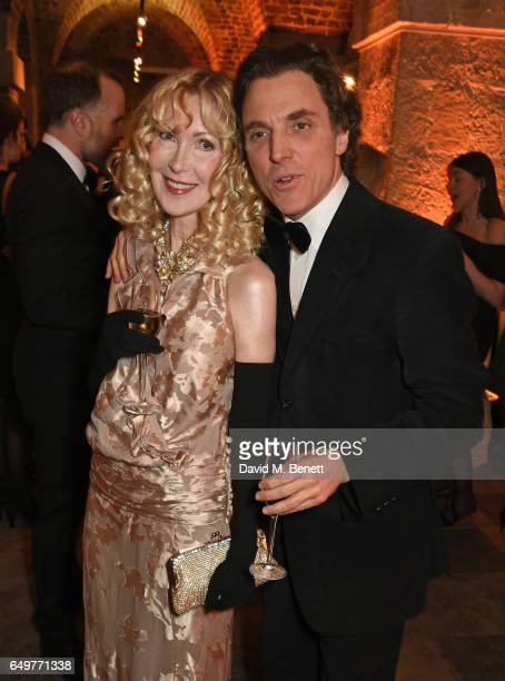 Basia Briggs and Alexander Newley attend the St MartinintheFields Gala Dinner and auction of Alexander Newley portraits on March 8 2017 in London...