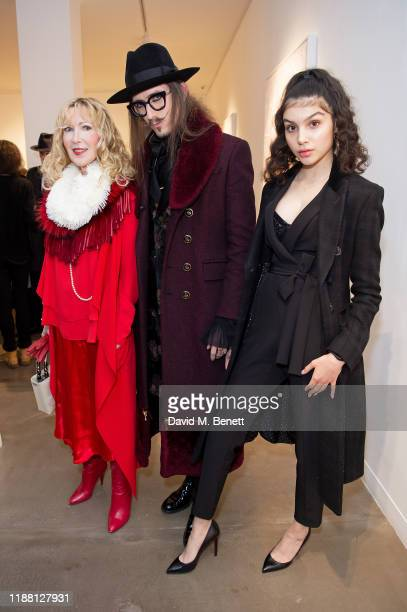Basia Briggs Joshua Kane and Anastasiya Higgins attend a private view of Lethe by Henrik Uldalen at JD Malat Gallery on December 12 2019 in London...