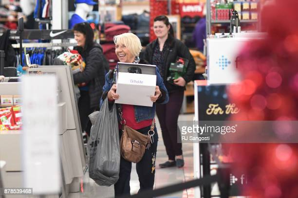 Basia Kmita smiles as she heads to the checkout line at Kohls during Black Friday November 24 2017 in Lakewood Colorado
