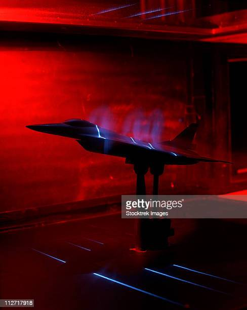 a basic flow visualization test of an f-16xl scamp model. - wind tunnel testing stock photos and pictures