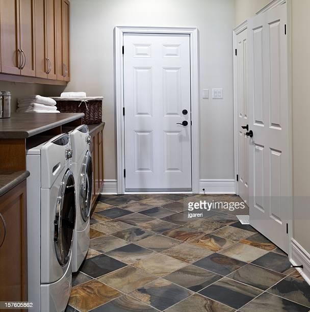 Basic laundry room with white doors