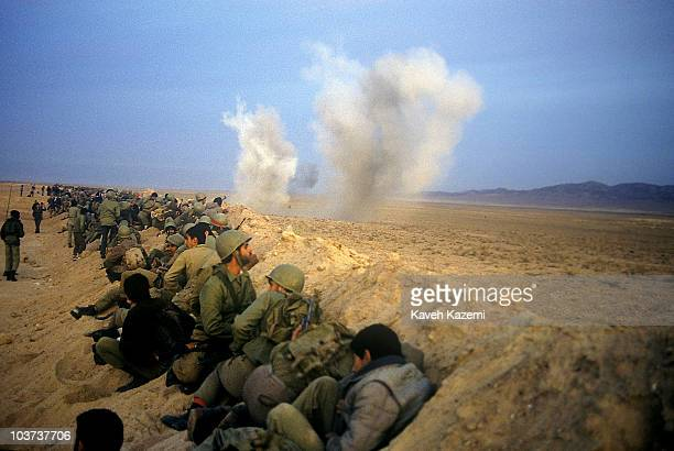 Basiji men participate in a military manoeuvre for the Iran-Iraq front in Robat-e-Karim outside Tehran, 19th November 1988.