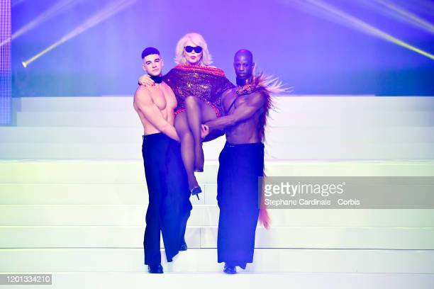 Basil Amanda Lear and Patrick Mombruno walk the runway during the JeanPaul Gaultier Haute Couture Spring/Summer 2020 show as part of Paris Fashion...