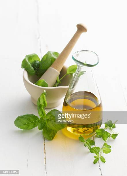 Basil and oregano leaf in mortar and pestle