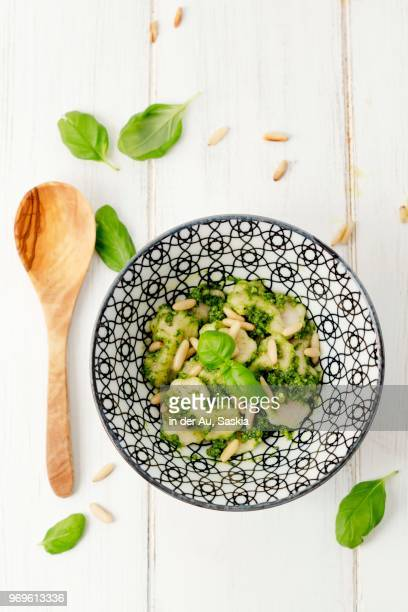 basil pesto with pasta and pine nuts - ピストー ストックフォトと画像