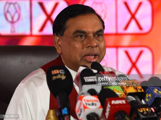 Basil Rajapaksa brother of Sri Lankan former president Mahinda Rajapaksa speaks during a Sri Lanka Podujana Peramuna party press conference in...