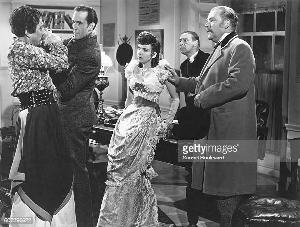 Basil Rathbone Ida Lupino and Nigel Bruce on the set of The Adventures of Sherlock Holmes directed by Alfred L Werker