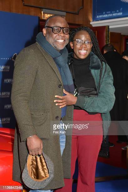 "Basile Boli and daughter attend ""Nicky Larson Et Le Parfum de Cupidon"" Premiere At Le Grand Rex on February 1, 2019 in Paris, France."