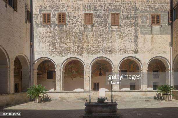 basilica di santa caterina d'alessandria lecce, salento, apulia, italy. - cloister stock pictures, royalty-free photos & images