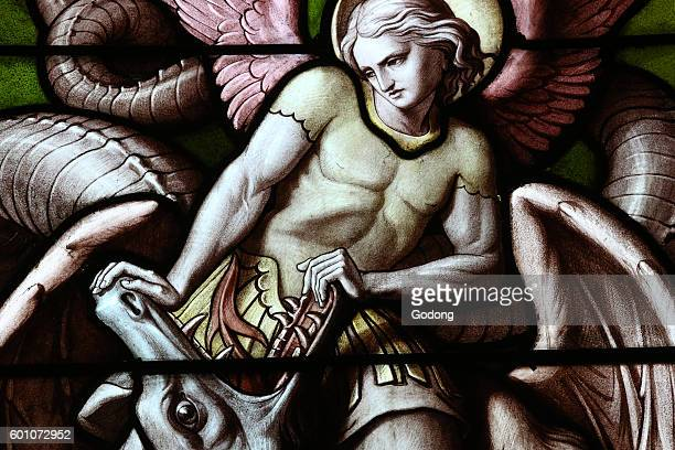 Basilica NotreDame of Geneva Stained glass window Angel fighting Satan as a dragon Geneva Switzerland