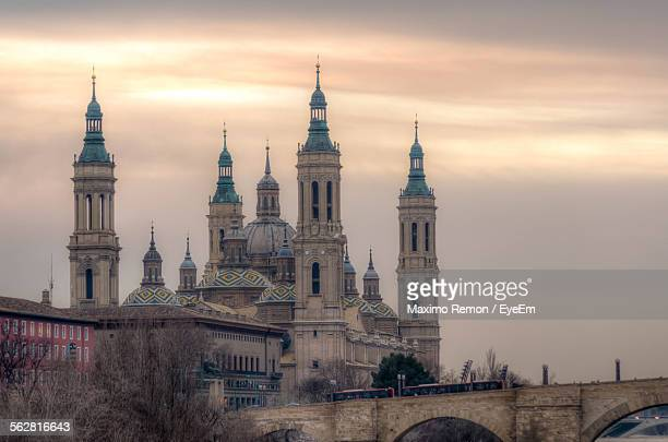 Basilica Of Our Lady Of The Pillar Against Cloudy Sky During Sunset