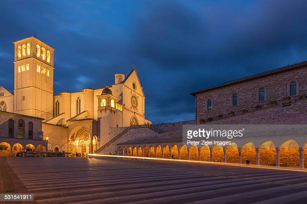 basilica of san francesco d'assisi by night - st. francis of assisi stock photos and pictures