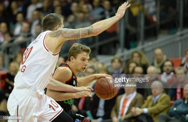 Bayern Munich vs Brose Baskets Bamberg at the Audi Dome sports venue in Munich Germany 11 February 2015 Munich's Heiko Schaffartzik and Bambergs's...
