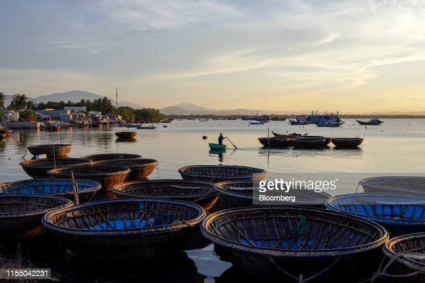 Basket boats sit moored in Tan Quang harbor in Quang Nam province Vietnam on Wednesday June 26 2019 Fishermen are on the front lines of Asias most...