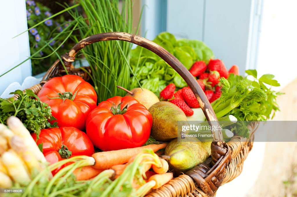 Basket full of fresh fruit and vegetables : Stock Photo