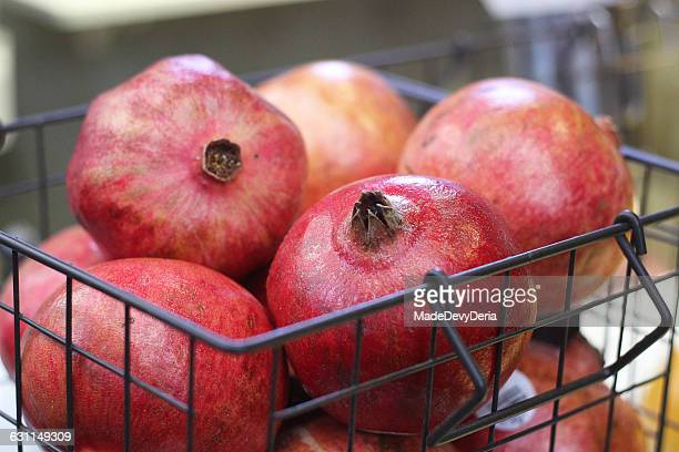 A basket full of pomegranate