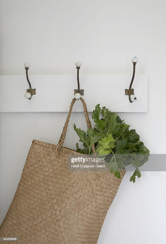 basket hanging on hook with vegtables in : ストックフォト