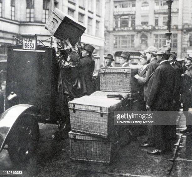 Basket loads of money loaded on a vehicle during Weimar German Hyperinflation 1923 In economics hyperinflation is very high and typically...