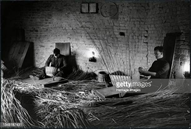 Basket makers, King's Sedge Moor, High Ham, South Somerset, Somerset, 1930s. Basket weavers at work in a small factory on King's Sedge Moor. The...