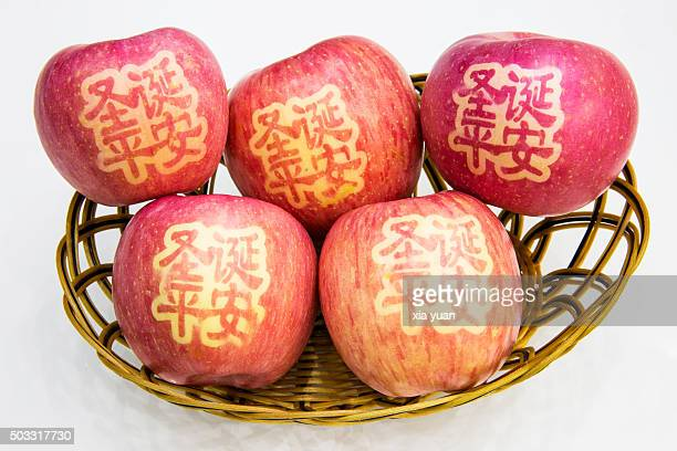 Basket of apples with Chinese character on it,means'Merry Christmas'