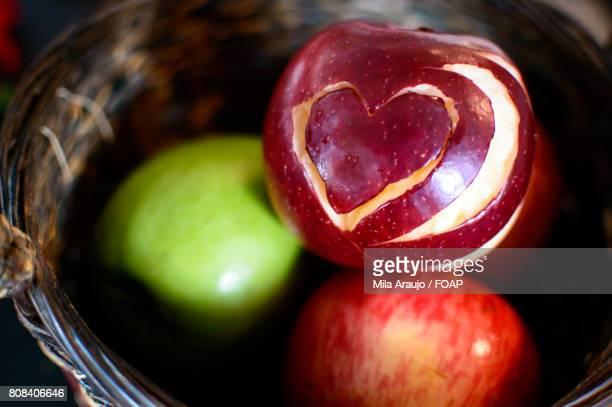 Basket of apples with heart shaped