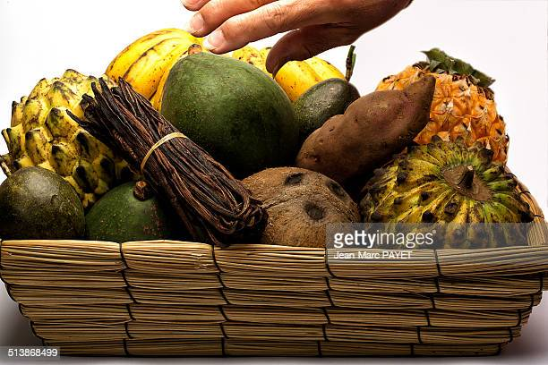 basket of assorted exotic fruits - jean marc payet stock pictures, royalty-free photos & images