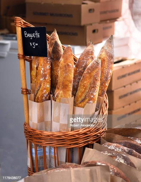 A basket of baguettes for sale at a Saturday farmers market in downtown Denver Colorado