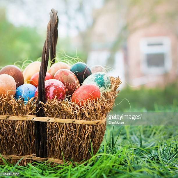 basket of colorful easter eggs - easter basket stock pictures, royalty-free photos & images