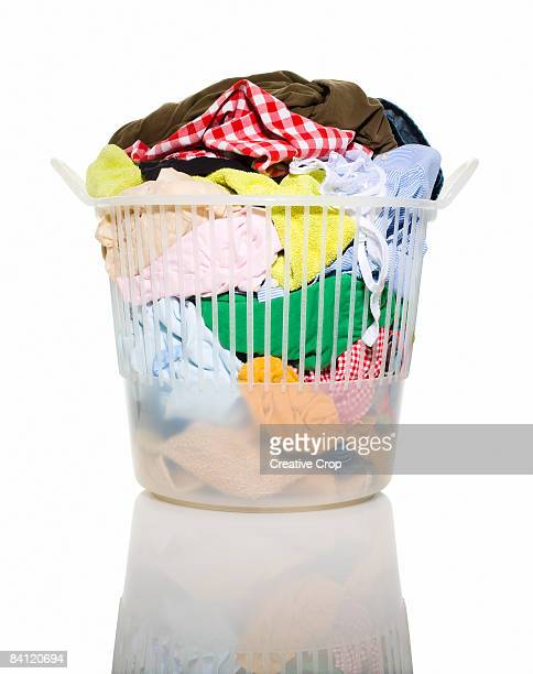 Basket of dirty washing in laundry basket