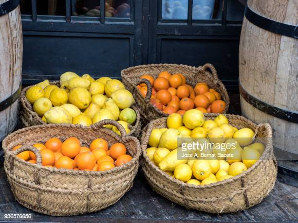 Basket of esparto grass with oranges and lemons for his sale on a market outdoor.